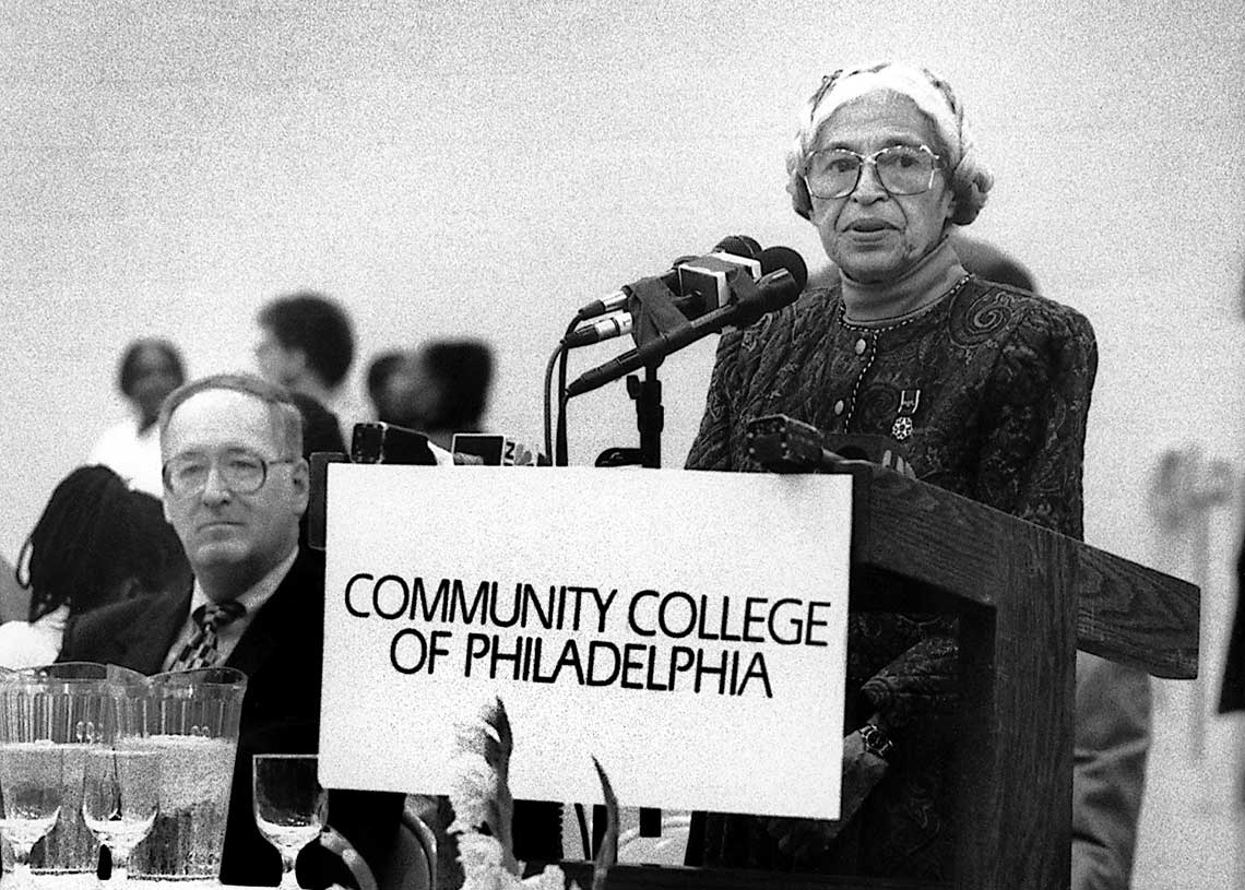 Rosa Parks Speaking from behind a podium