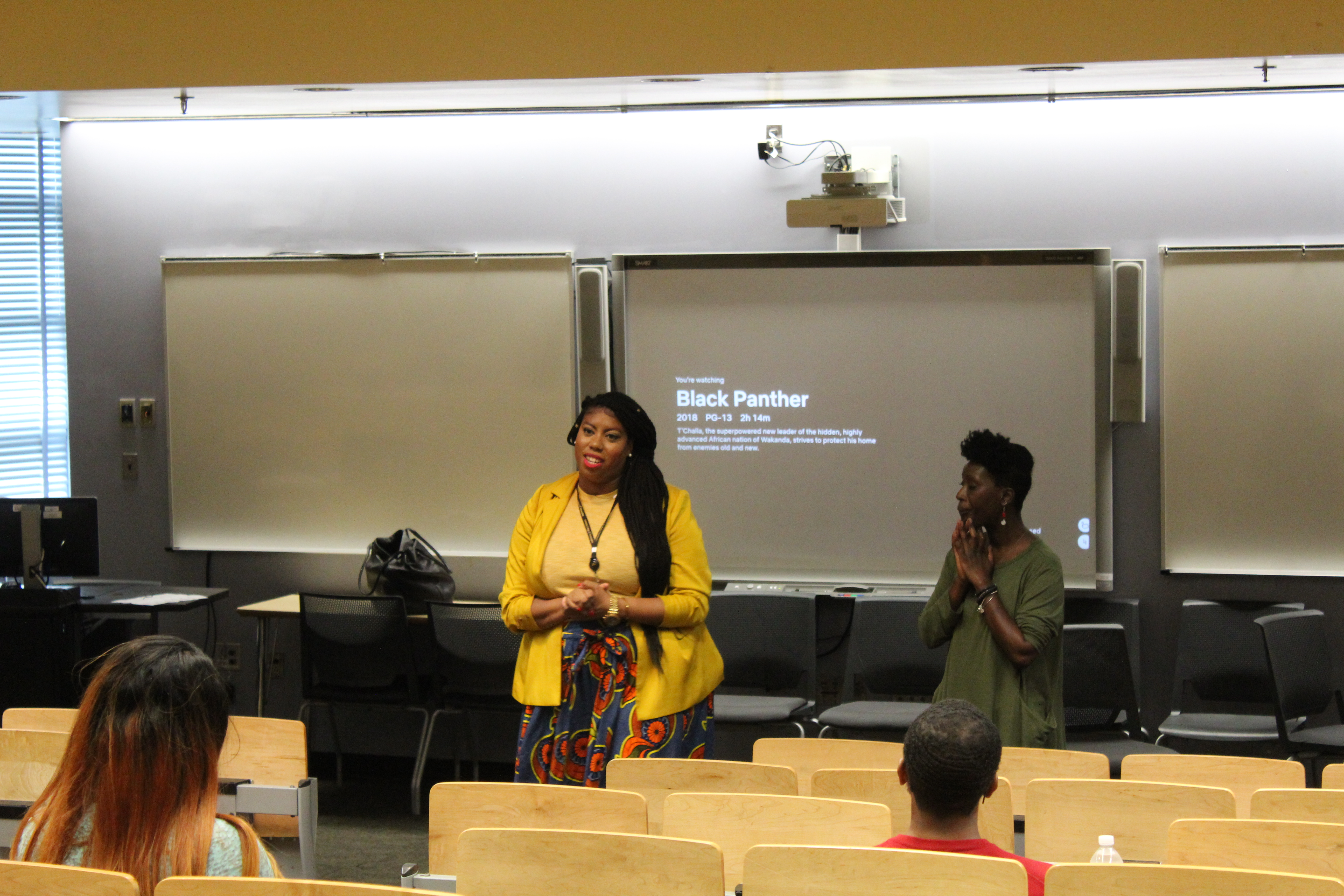Debonair Oates-Primus and Lucia Gbaya-Kanga discuss CCP's new Black Studies program to students.