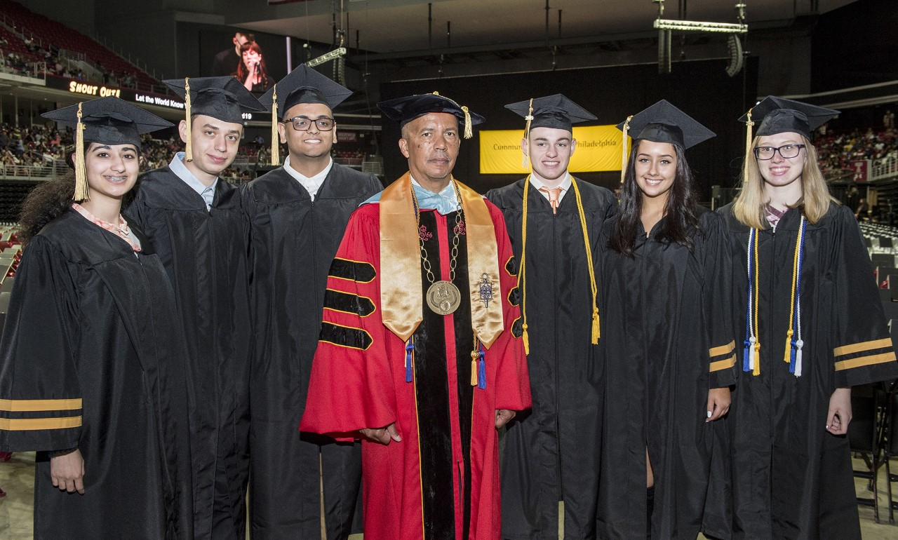 The six MaST seniors at CCP's 53rd commencement with Dr. Guy Generals, president of the College.