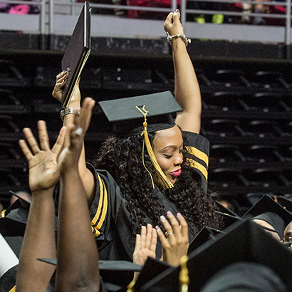 Graduate celebrating with arm up