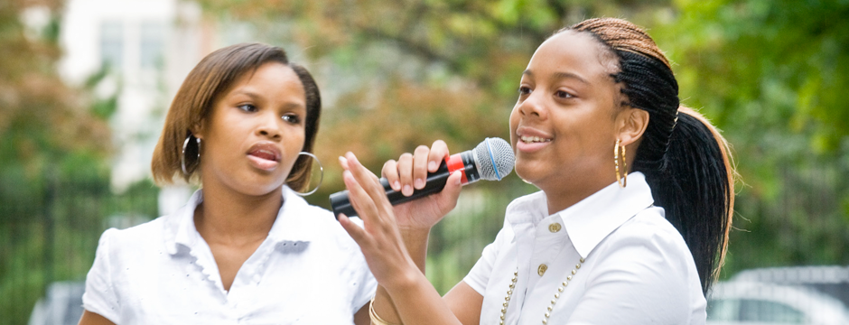students at microphone