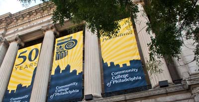 The mint Building with banners celebrating 50 years of Community College of Philadelphia