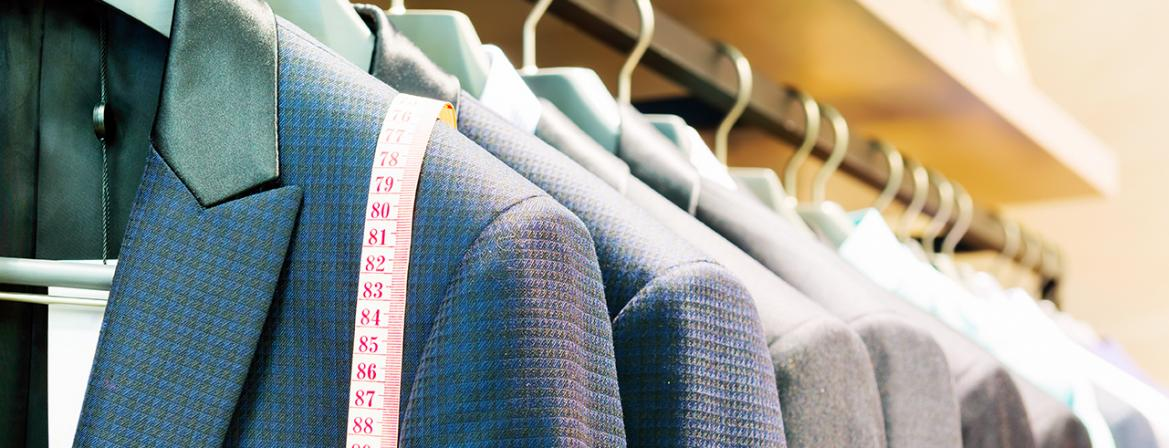 Suit jackets on hangers in a shop