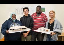 Architecture students holding their design models in CCP class.