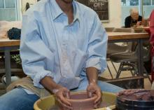 Art student working with clay at CCP.
