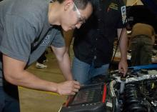 Automotive Technology student working on car engine at CCP.