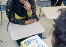 Students talk in a CCP classroom.