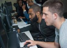 Students working on computers at Community College of Philadelphia.