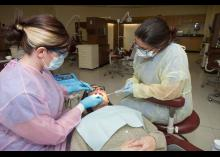 Students performing dental exam in CCP clinic.
