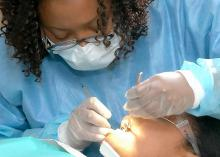 CCP student performing dental checkup in clinic.