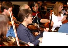 Students playing in the string section of orchestra at CCP.