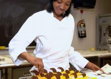 Student making food in Culinary Arts program at Community College of Philadelphia.