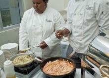 Students in the Culinary Arts program cooking food at CCP.