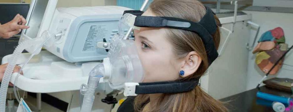 CCP student in respiratory care testing machine.