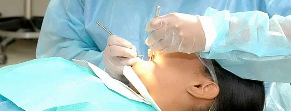 CCP student performing dental cleaning in clinic.