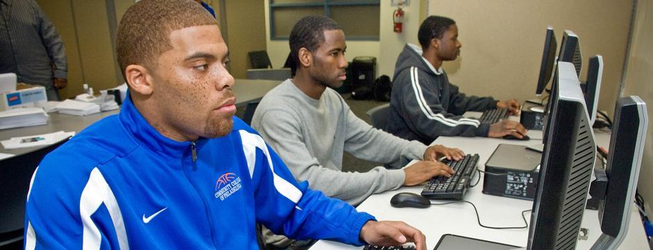 Student at computer terminal