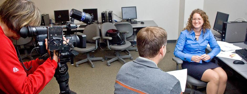student working digital video camera