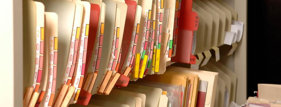 Paper medical files in office at CCP.